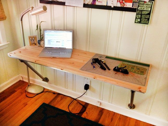 Countertop Desk : 12. Wood and Pipe DIY Desk : Turn a wooden countertop into a desk with ...