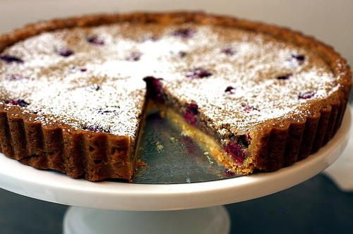 This cranberry speckled tart is a real show stopper. Dusted with ...