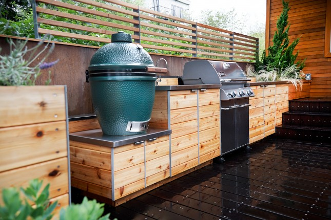 25 of the most gorgeous outdoor kitchens brit co for Cedar outdoor kitchen cabinets